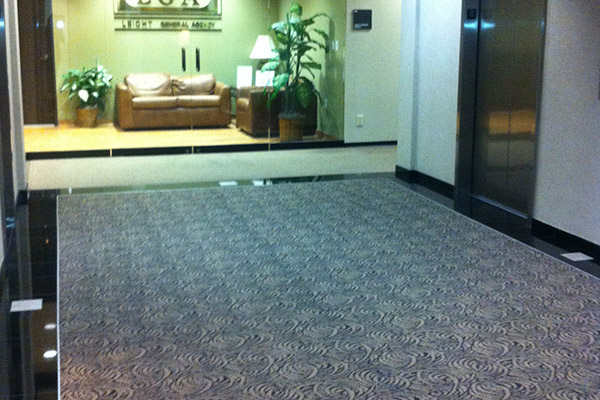 Carpet and tile floor installation in a Houston building.