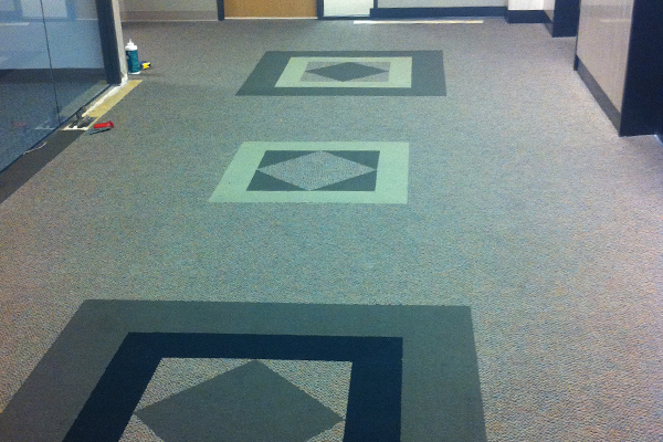 Carpet with inlay installation in Houston.