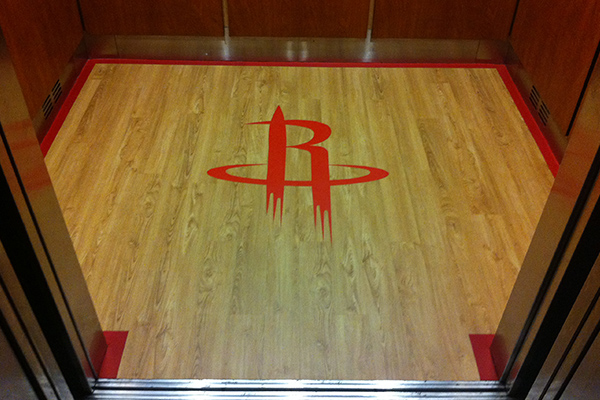 Luxury vinyl floor tile with inlays at the Houston Toyota Center.