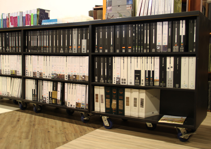 Carpet, laminate and vinyl tile sample books in the Texas Floor Covering, Inc. showroom