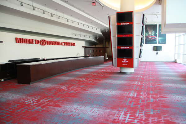 Carpet floor installation in a Houston sports arena.
