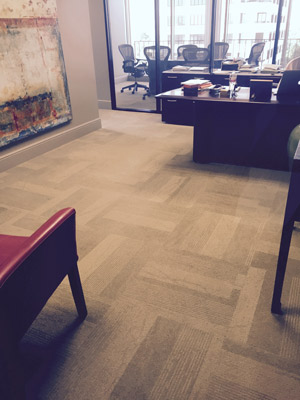 Carpet tile floor installation in a Houston office building.