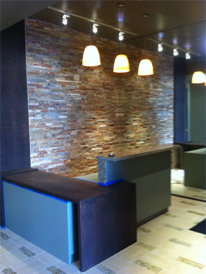 Ceramic tile and rock wall installation in Houston.